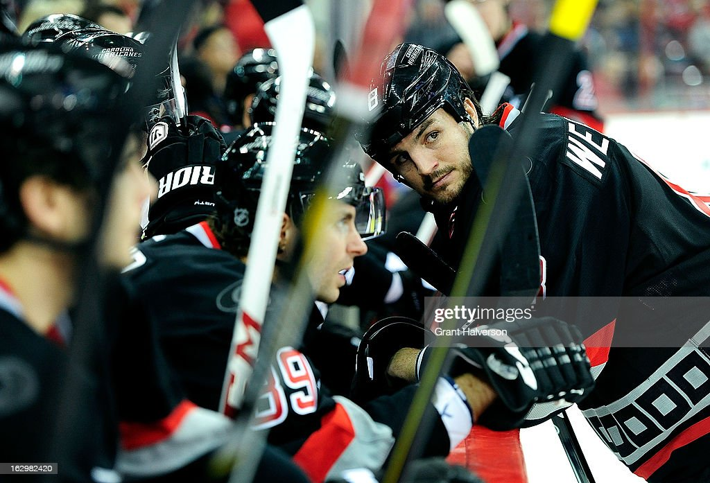 Kevin Westgarth #8 of the Carolina Hurricanes listens to insults from the Florida Panthers bench during play at PNC Arena on March 2, 2013 in Raleigh, North Carolina. The Hurricanes won 6-2.