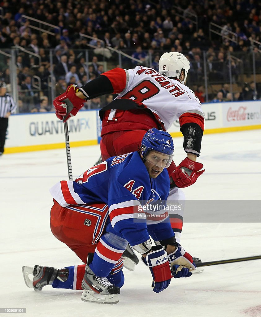 Kevin Westgarth of the Carolina Hurricanes skates away after taking a penalty against Steve Eminger of the New York Rangers at Madison Square Garden...