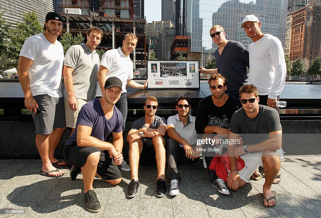 Kevin Westgrath, Brad Richardson, Dustin Brown, Rob Scuderi, Jeff Carter. (Front Row L-R) Kyle Clifford, Trevor Lewis, Alec Martinez, Jarret Stoll and Matt Greene lay a plaque at the reflexting pool above the engraved names of Garnet 'Ace' Bailey, the Kings' director of pro scouting, and amateur scout Mark Bavis in lower Manhattan at the World Trade Center site on September 12, 2012 in New York City. The Los Angeles Kings marked the loss of Garnet 'Ace' Bailey, the Kings' director of pro scouting, and amateur scout Mark Bavis when hijackers took control of their scheduled Boston-to-Los Angeles flight and crashed the plane into the south tower of New York's World Trade Center.
