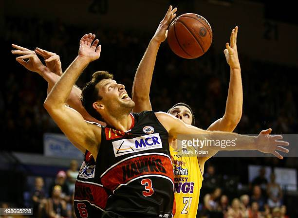 Kevin White of the Hawks and Jeromie Hill of the Kings contest possession during the round eight NBL match between the Illawarra Hawks and the Sydney...