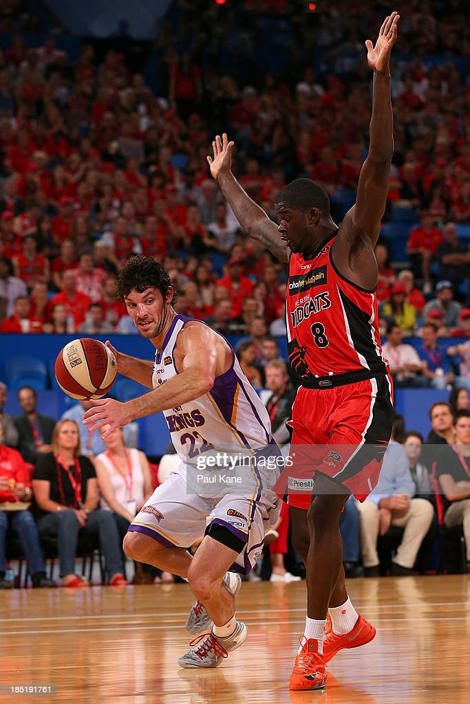Kevin White of the Kings drives around James Ellis of the Wildcats during the round two NBL match between the Perth Wildcats and the Sydney Kings at Perth Arena in October 18, 2013 in Perth, Australia.
