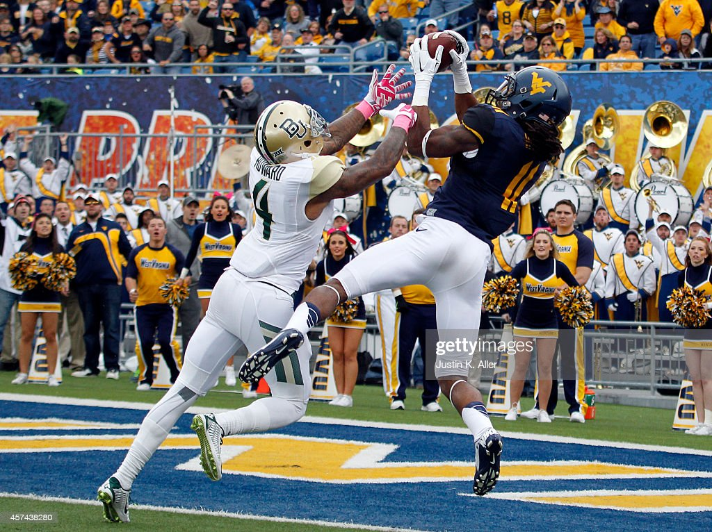 Kevin White of the West Virginia Mountaineers catches a 36 yard touchdown in the first quarter against Xavien Howard of the Baylor Bears during the...