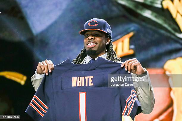 Kevin White of the West Virginia Mountaineers holds up a jersey after being chosen overall by the Chicago Bears during the first round of the 2015...