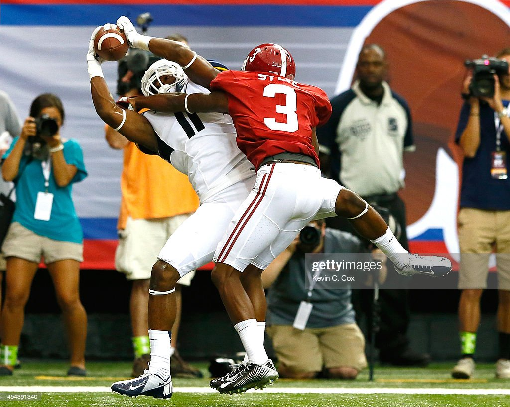 Kevin White of the West Virginia Mountaineers pulls in this touchdown reception against Bradley Sylve of the Alabama Crimson Tide at Georgia Dome on...