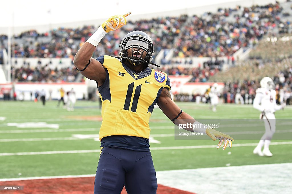 Kevin White of the West Virginia Mountaineers reacts to a touchdown against the Texas AM Aggies during the second quarterof the 56th annual Autozone...