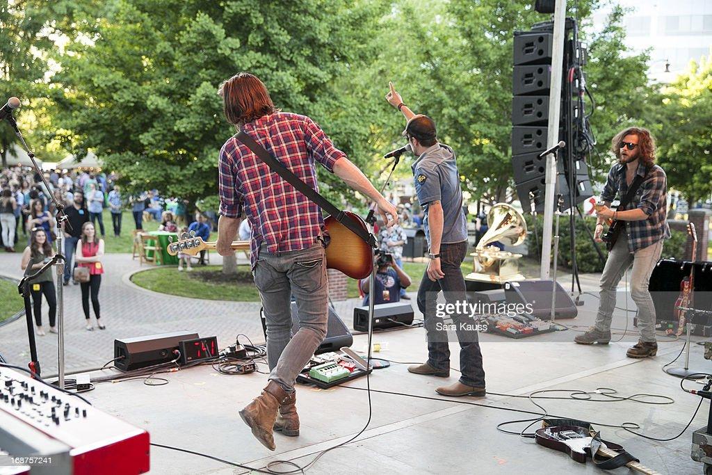 Kevin Whitsett Rhett Walker and Joe Kane of the Rhett Walker Band perform at the GRAMMY Block Party at Owen Bradley Park on May 14 2013 in Nashville...