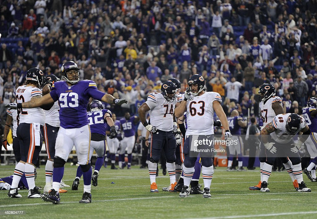 Kevin Williams #93 of the Minnesota Vikings celebrates as the Chicago Bears react to a missed 47-yard field goal attempt during overtime of the game on December 1, 2013 at Mall of America Field at the Hubert H. Humphrey Metrodome in Minneapolis, Minnesota. The Vikings defeated the Bear 23-20 in overtime.