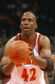 Kevin Willis of the Atlanta Hawks shoots a free throw against the San Antonio Spurs during the game on November 13 2004 at Philips Arena in Atlanta...