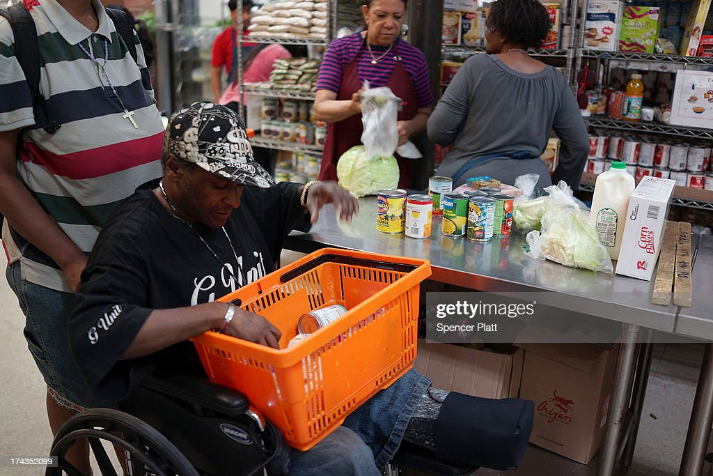 Kevin Wilson, a client of the West Side Campaign Against Hunger food pantry, shops for food on July 24, 2013 in New York City. The food pantry assists thousands of qualifying New York residents in providing a monthly allotment of food. In an anticipated speech today in Illinois, President Obama tried to re-focus the nations attention back onto the economy and the growing inequality between the rich and the rest of America. As of May 2013 the unemployment rate in America was stuck at 7.6% with many more Americans having given up on looking for work.