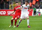 Kevin Wimmer 1 FC Koeln challenges Nils Petersen of SC Freiburg during the Bundesliga match between Sport Club Freiburg and 1 FC Koeln at...