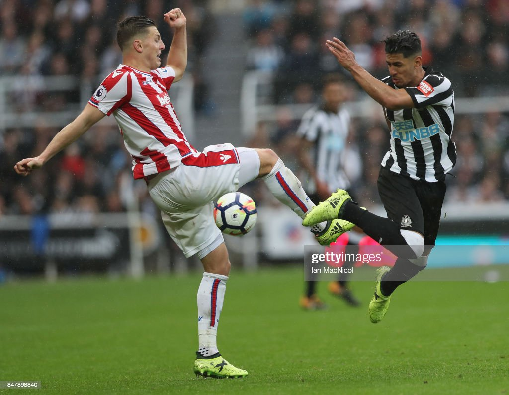 Kevin Wimmer of Stoke City and Ayoze Perez of Newcastle United battle for possession during the Premier League match between Newcastle United and Stoke City at St. James Park on September 16, 2017 in Newcastle upon Tyne, England.