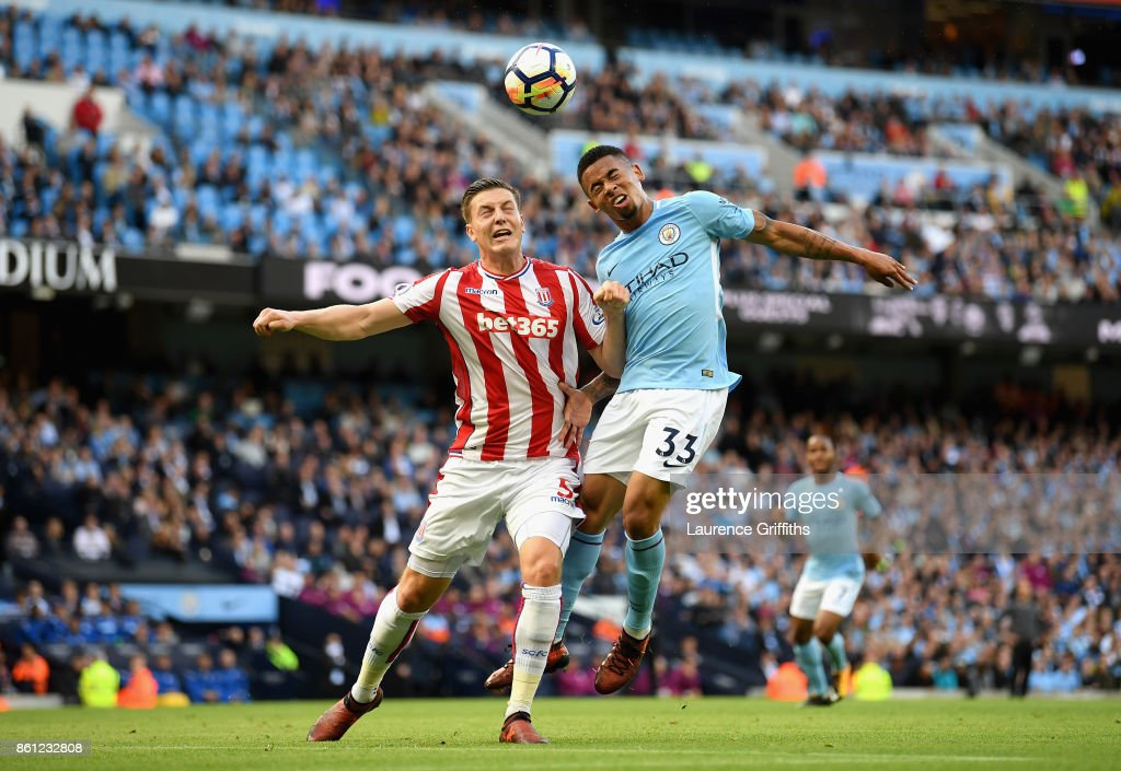 Kevin Wimmer of Stoke City and Gabriel Jesus of Manchester City battle for possession in the air during the Premier League match between Manchester City and Stoke City at Etihad Stadium on October 14, 2017 in Manchester, England.
