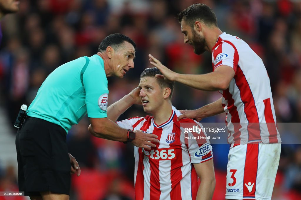 Kevin Wimmer of Stoke City reacts to an injuryduring the Premier League match between Stoke City and Manchester United at Bet365 Stadium on September 9, 2017 in Stoke on Trent, England.