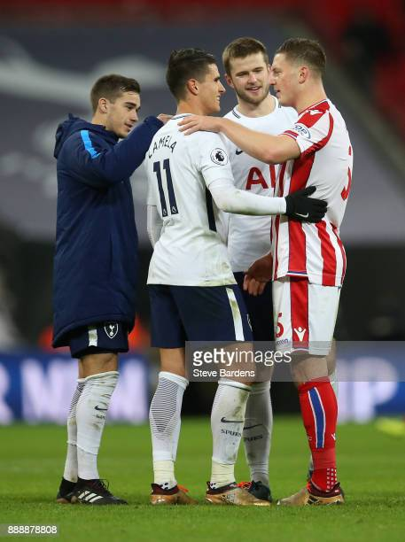 Kevin Wimmer of Stoke City with Erik Lamela Harry Winks and Eric Dier of Tottenham Hotspur after the Premier League match between Tottenham Hotspur...