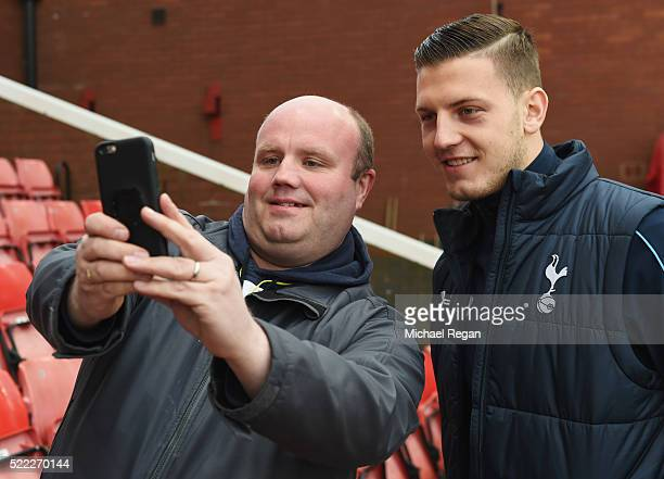 Kevin Wimmer of Tottenham Hotspur poses for a selfie photograph with a fan prior to the Barclays Premier League match between Stoke City and...