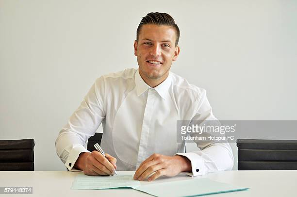 Kevin Wimmer of Tottenham Hotspur poses with his new contract on July 21 2016 in Enfield England