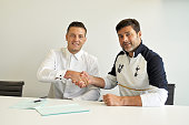 Kevin Wimmer of Tottenham Hotspur poses with manager Mauricio Pochettino on July 21 2016 in Enfield England