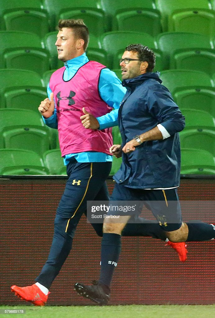 Kevin Wimmer (L) of Tottenham Hotspur runs during a Tottenham Hotspur training session at AAMI Park on July 25, 2016 in Melbourne, Australia.