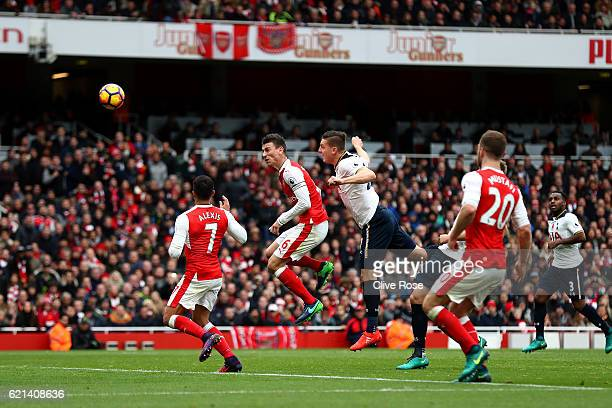 Kevin Wimmer of Tottenham Hotspur scores an own goal for Arsenals first during the Premier League match between Arsenal and Tottenham Hotspur at...