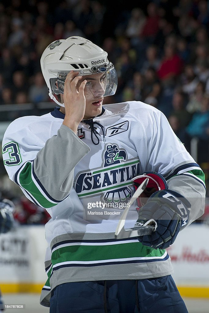 Kevin Wolf #3 of the Seattle Thunderbirds adjusts his helmet at the Kelowna Rockets on October 11, 2013 at Prospera Place in Kelowna, British Columbia, Canada
