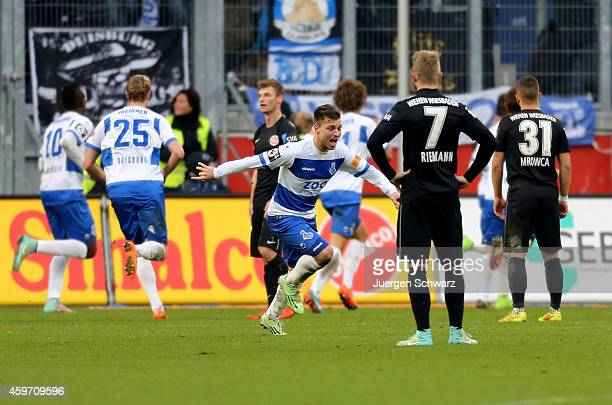 Kevin Wolze of Duisburg celebrates after the third goal of his team during the Third League match between MSV Duisburg and SV Wehen Wiesbaden at...