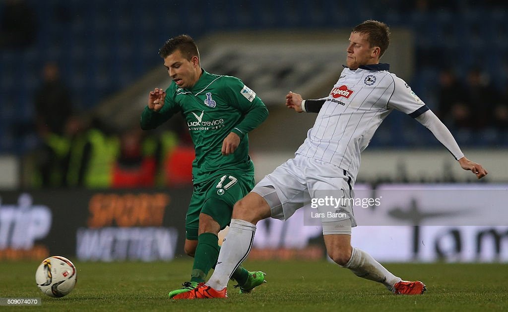 Kevin Wolze of Duisburg is challenged by Brian Behrendt of Bielefeld during the Second Bundesliga match between Arminia Bielefeld and MSV Duisburg at Schueco Arena on February 8, 2016 in Bielefeld, Germany.