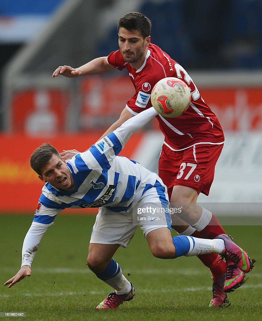 Kevin Wolze of Duisburg is challenged by Markus Karl of Kaiserslautern during the Second Bundesliga match between MSV Duisburg and 1. FC Kaiserslautern at Schauinsland-Reisen-Arena on February 17, 2013 in Duisburg, Germany.