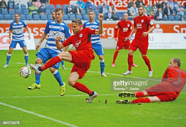 Kevin Wolze of Duisburg Sebastian Schuppan and Brian Behrendt of Bielefeld fight for the ball during the Second Bundesliga match between MSV Duisburg...