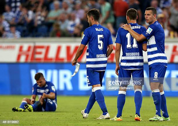 Kevin Wolze of Duisburg sits on the pitch near Thomas Broeker Stanislav Iljutcenko and Branimir Bajic after the 2nd Bundesliga match between MSV...