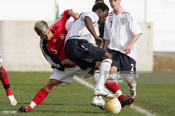 Kevin Wolze of Germany challenges Victor Moses of England during the Men's U17 international Tournament match between Englad and Germany at the...