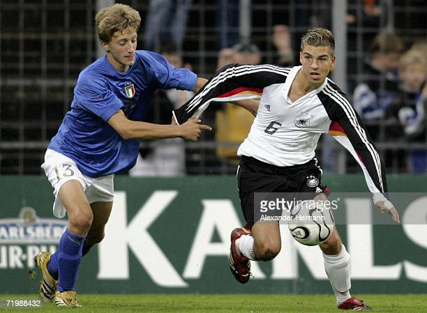 Kevin Wolze of Germany competes with Pietro Baccolo of Italy during the Men's Under 17 Four Nation Tournament between Germany and Italy at the Wald...
