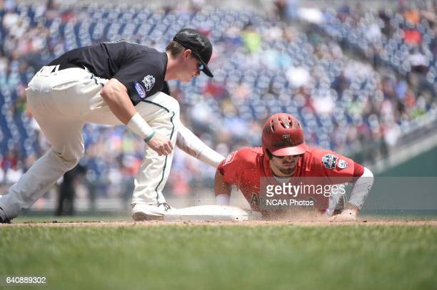 Kevin Woodall Jr of Coastal Carolina University tags the runner on a pickoff move against the University of Arizona during Game 3 of the Division I...