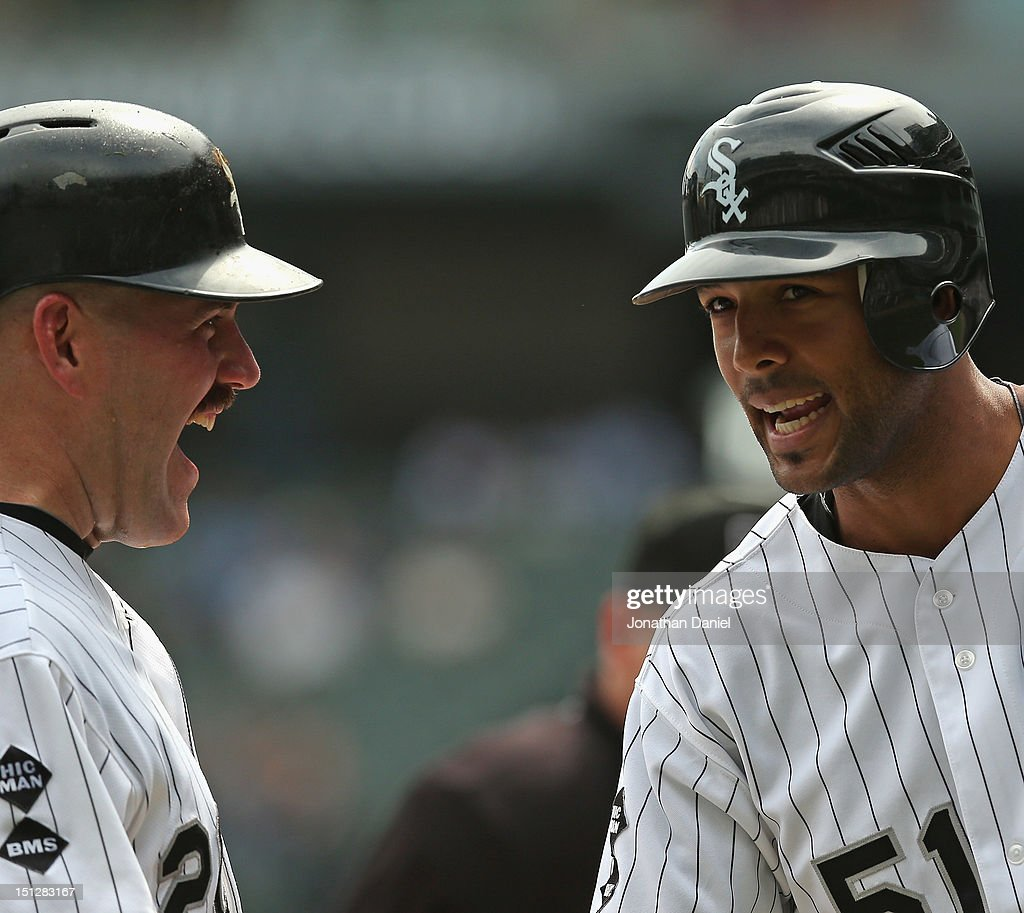 Kevin Youkilis #20 (L) and Alex Rios #51 and of the Chicago White Sox celebrate Rios's grand slam home run in the 1st inning against the Minnesota Twins at U.S. Cellular Field on September 5, 2012 in Chicago, Illinois.