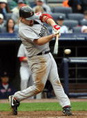 Kevin Youkilis of the Boston Red Sox connects for a third inning single against the New York Yankees on September 27 2009 at Yankee Stadium in the...