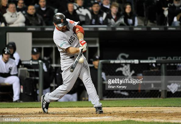 Kevin Youkilis of the Boston Red Sox connects on a grand slam scoring teammates David Ortiz Adrian Gonzalez and Ryan Sweeney during the third inning...