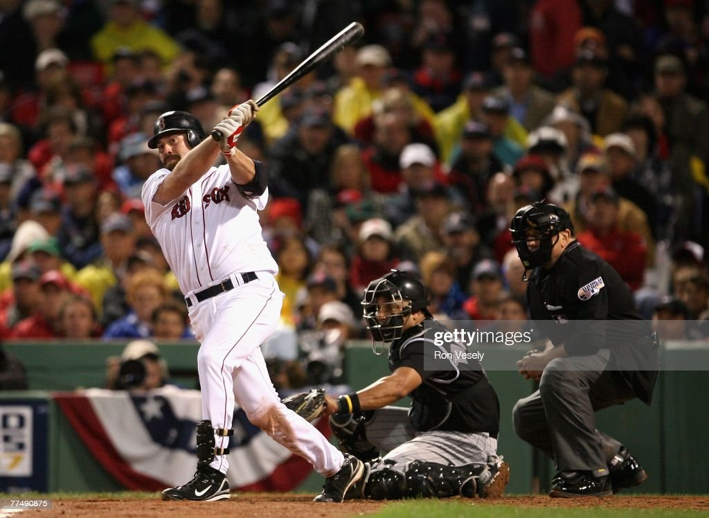 Kevin Youkilis #20 of the Boston Red Sox hits a RBI double during the fifth inning of Game One of the 2007 World Series against the Colorado Rockies at Fenway Park on October 24, 2007 in Boston, Massachusetts.