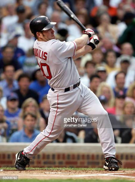 Kevin Youkilis of the Boston Red Sox hits a solo home run in the first inning against the Chicago Cubs on June 12 2005 at Wrigley Field in Chicago...