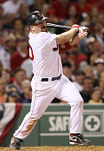Kevin Youkilis of the Boston Red Sox hits a triple against the New York Yankees on April 4 2010 during Opening Night at Fenway Park in Boston...