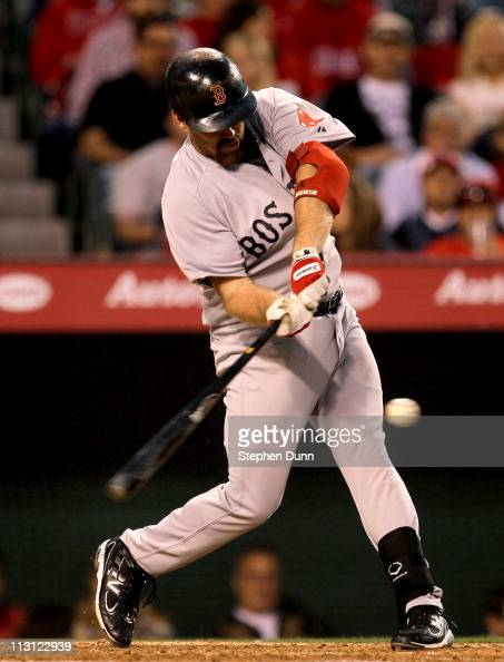 Kevin Youkilis of the Boston Red Sox hits a two run home run in the fifht inning against the Los Angeles Angels of Anaheim on April 23 2011 at Angel...