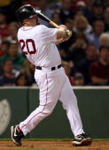 Kevin Youkilis of the Boston Red Sox hits a two run homer in the first inning against the Toronto Blue Jays on September 28 2009 at Fenway Park in...