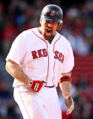 Kevin Youkilis of the Boston Red Sox reacts after flying out in the eighth inning against the Los Angeles Angels on May 5 2011 at Fenway Park in...