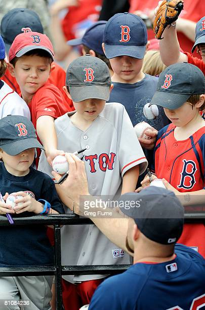 Kevin Youkilis of the Boston Red Sox signs autographs before the game against the Baltimore Orioles May 14 2008 at Camden Yards in Baltimore Maryland