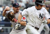 Kevin Youkilis of the Boston Red Sox throws out Brett Gardner of the New York Yankees on September 27 2009 at Yankee Stadium in the Bronx borough of...