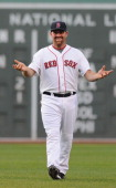 Kevin Youkilis of the Boston Red Sox warms up prior to the game against the Miami Marlins during interleague play at Fenway Park on June 20 2012 in...