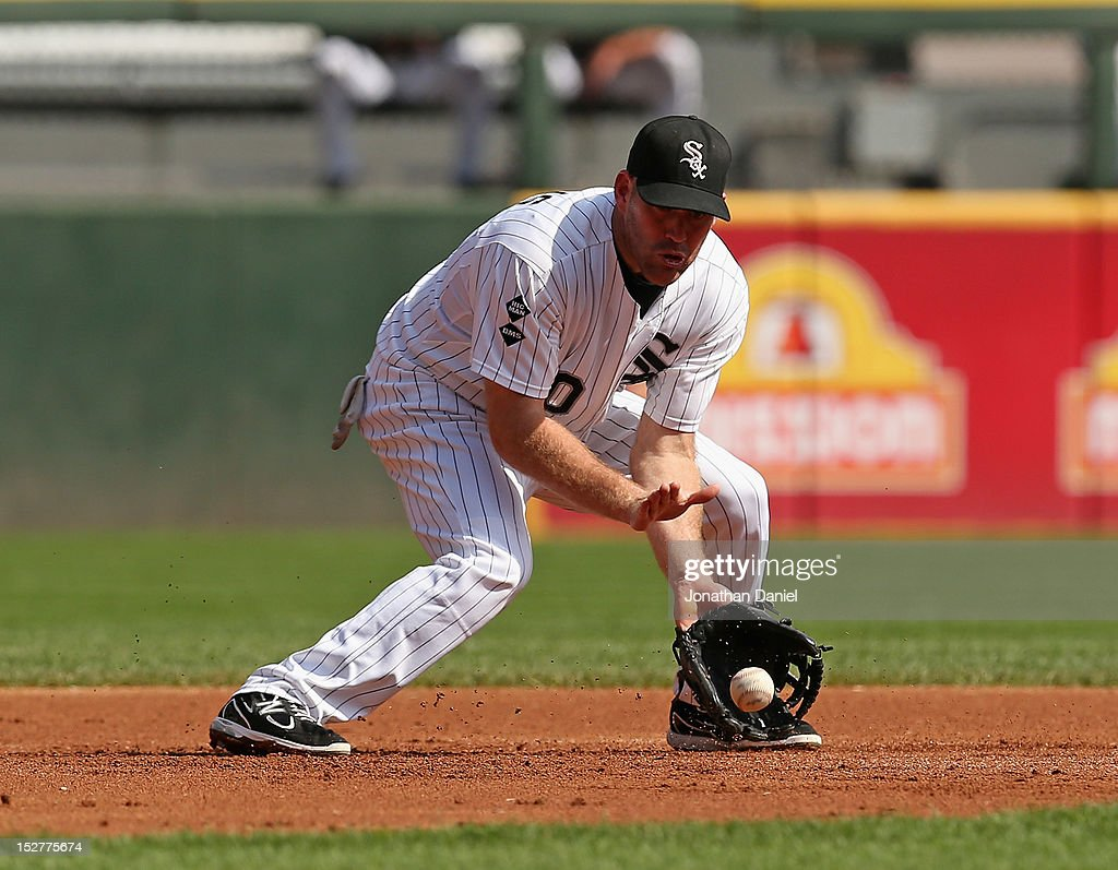 <a gi-track='captionPersonalityLinkClicked' href=/galleries/search?phrase=Kevin+Youkilis&family=editorial&specificpeople=206888 ng-click='$event.stopPropagation()'>Kevin Youkilis</a> #20 of the Chicago White Sox fields a ball against the Cleveland Indians at U.S. Cellular Field on September 25, 2012 in Chicago, Illinois. The Indians defeated the White Sox 4-3.