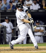 Kevin Youkilis of the Chicago White Sox hits a home run in the fourth inning against the Detroit Tigers on September 12 2012 at US Cellular Field in...