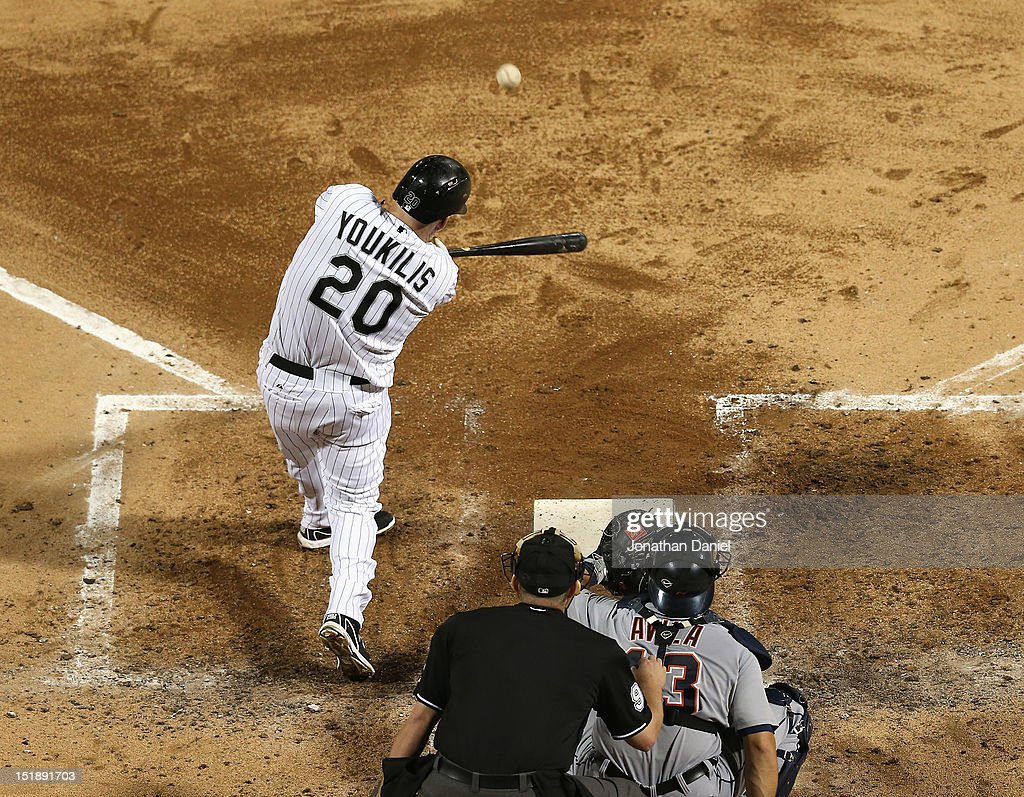 <a gi-track='captionPersonalityLinkClicked' href=/galleries/search?phrase=Kevin+Youkilis&family=editorial&specificpeople=206888 ng-click='$event.stopPropagation()'>Kevin Youkilis</a> #20 of the Chicago White Sox hits a solo home run in the 4th inning against the Detroit Tigers at U.S. Cellular Field on September 12, 2012 in Chicago, Illinois.