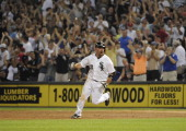 Kevin Youkilis of the Chicago White Sox hits a walk off game winning single in the tenth inning against the Texas Rangers on July 4 2012 at US...