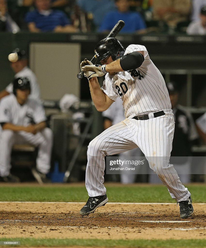 <a gi-track='captionPersonalityLinkClicked' href=/galleries/search?phrase=Kevin+Youkilis&family=editorial&specificpeople=206888 ng-click='$event.stopPropagation()'>Kevin Youkilis</a> #20 of the Chicago White Sox is hit by a pitch against the New York Yankees at U.S. Cellular Field on August 22, 2012 in Chicago, Illinois. The White Sox defeated the Yankees 2-1.