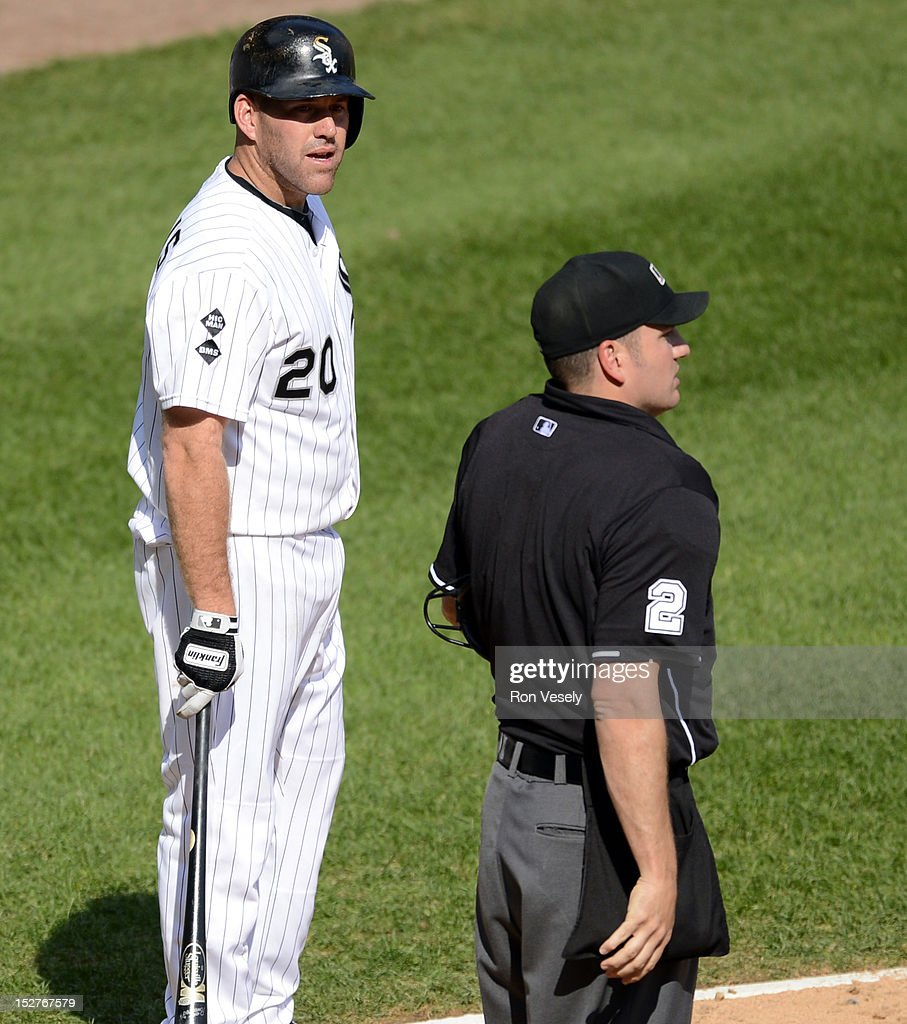 Kevin Youkilis #20 of the Chicago White Sox pleads his case to home plate umpire Dan Bellino #2 after being called out on strikes against the Cleveland Indians on September 25, 2012 at U.S. Cellular Field in Chicago, Illinois. The Indians defeated the White Sox 4-3.